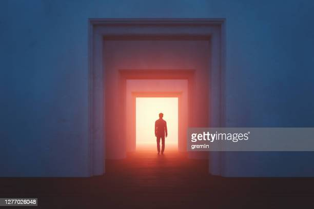 old rooms with sleepwalker walking into mysterious passage - door stock pictures, royalty-free photos & images