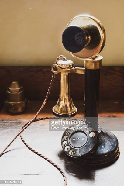 old rotary phone on table - bicester village stock pictures, royalty-free photos & images