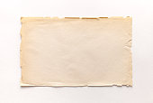 Old rough recycled paper with ragged edges on a white background with a shadow.