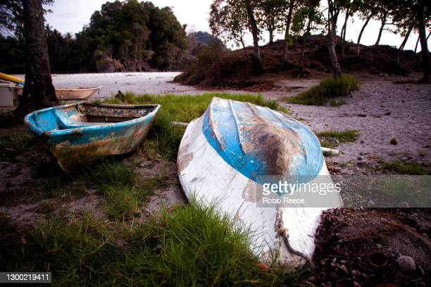 old rowboats on the beach in costa rica - robb reece stock pictures, royalty-free photos & images
