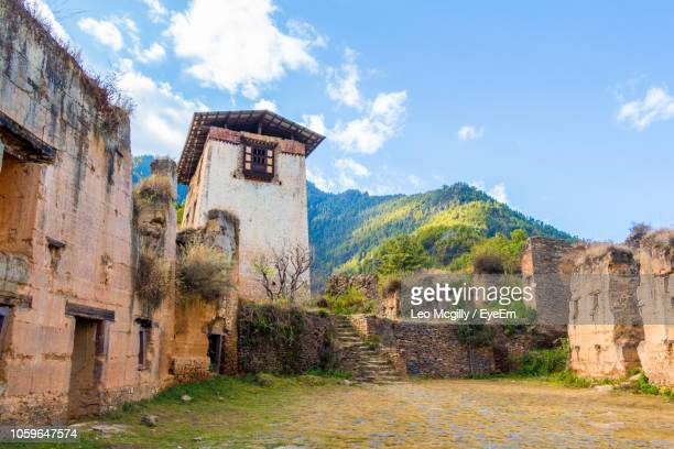 old ruin building against sky - paro district stock pictures, royalty-free photos & images