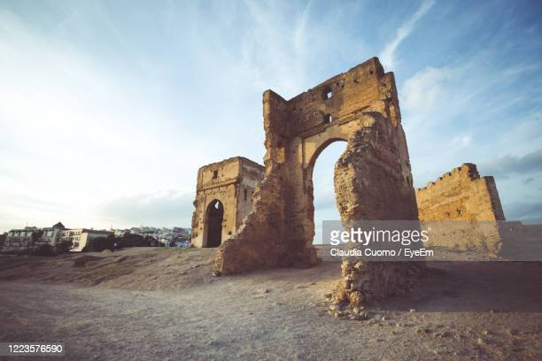old ruin building against sky - cuomo stock pictures, royalty-free photos & images