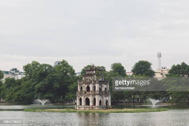 old ruin by river - bortes foto e immagini stock