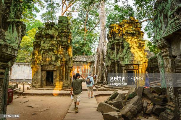 Old ruin of Ta Prohm Temple at Siem Reap with tourist