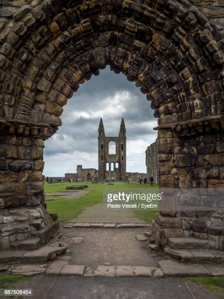 old ruin seen through arch against sky - st. andrews scotland stock pictures, royalty-free photos & images