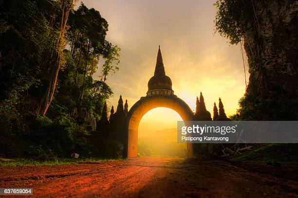 Old ruined arch in ancient temple at sunrise in Thailand.
