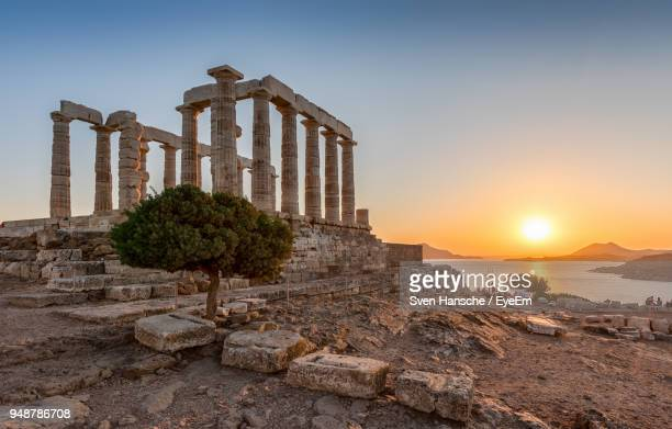 old ruins against sky during sunset - athens greece stock pictures, royalty-free photos & images