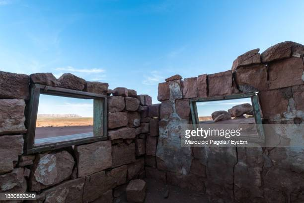 old ruins against sky on the dwellers near page, arizona - cliff dwelling stock pictures, royalty-free photos & images