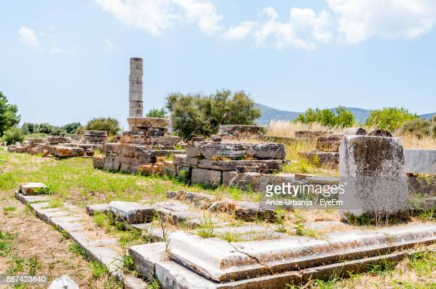 old ruins amidst field against sky - samos stock photos and pictures