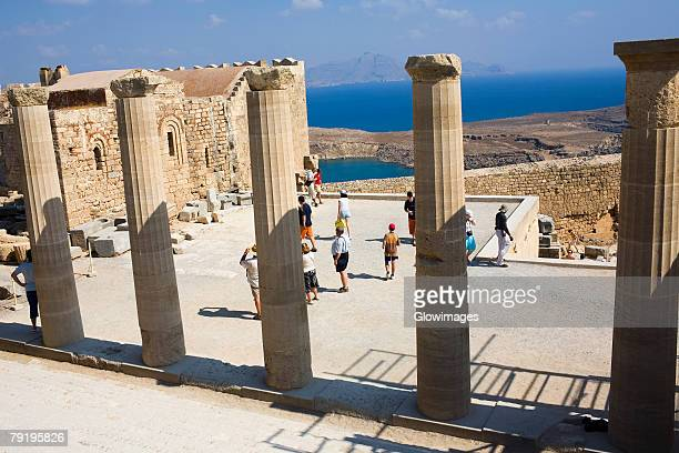 old ruins of a temple, temple of athena lindia, acropolis, lindos, rhodes, dodecanese islands, greece - lindos stock photos and pictures