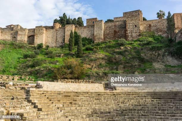 old ruins of an ancient roman stone theatre - istock stock-fotos und bilder