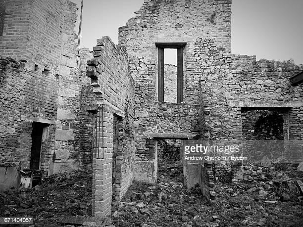 old ruins of building at oradour-sur-glane - world war ii stock pictures, royalty-free photos & images