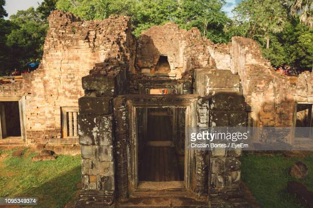old ruins of temple against trees - bortes stock pictures, royalty-free photos & images