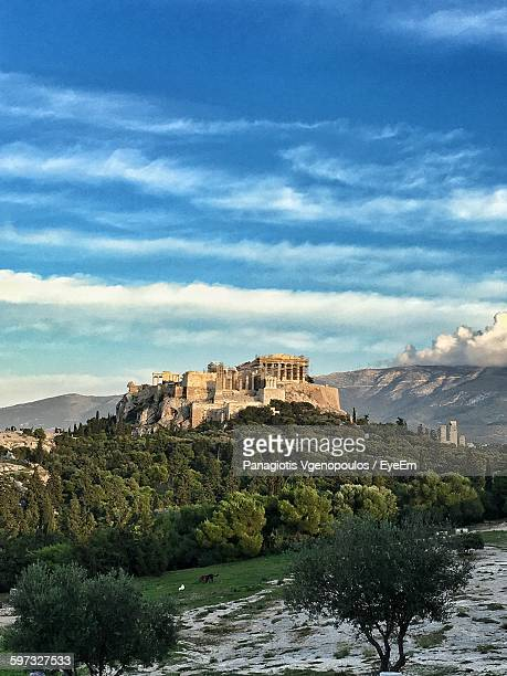 old ruins on mountain against cloudy sky - vgenopoulos stock pictures, royalty-free photos & images