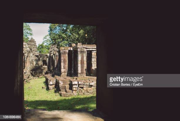 old ruins seen through entrance - bortes stock pictures, royalty-free photos & images