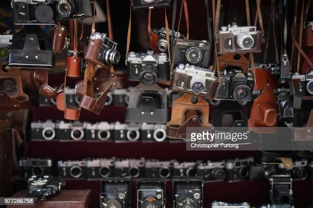 Old Russian cameras are seen for sale at a flea market in a suburb of Moscow on June 17 2018 in Moscow Russia Today saw the first shock result of the...