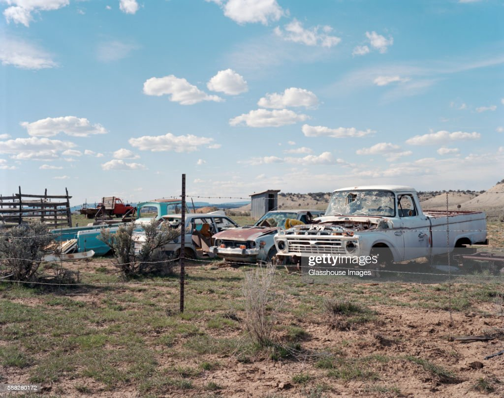 Old Rusted Cars With Bullet Holes In Windshields In Field Enclosed ...