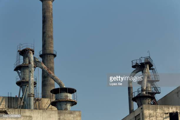 old rusted factory with stairs and chimney - liyao xie stock pictures, royalty-free photos & images