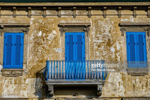 old rustic fasad with blue windows and doors - finn bjurvoll stock pictures, royalty-free photos & images