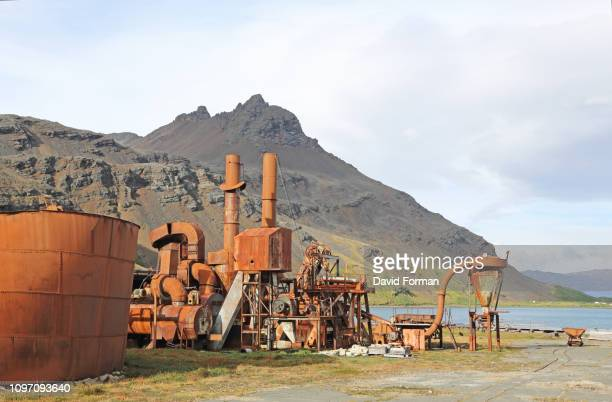 old rusting whaling machinery and vat, grytviken, south georgia. - atlantic islands stock pictures, royalty-free photos & images
