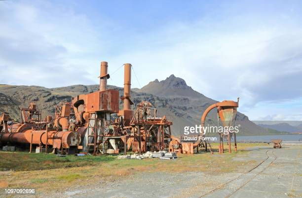 old rusting whaling machinery, grytviken, south georgia. - atlantic islands stock pictures, royalty-free photos & images