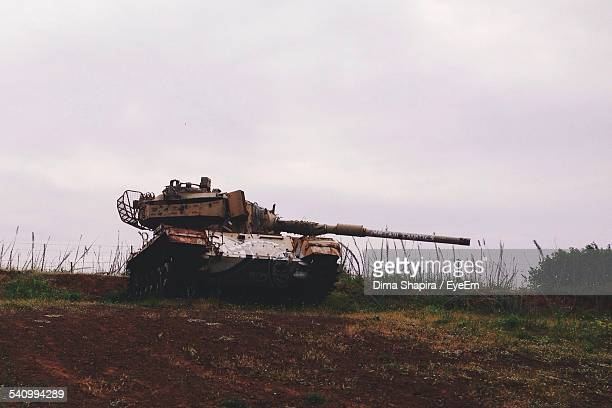 Old Rusty Armored Tank On Field Against Sky