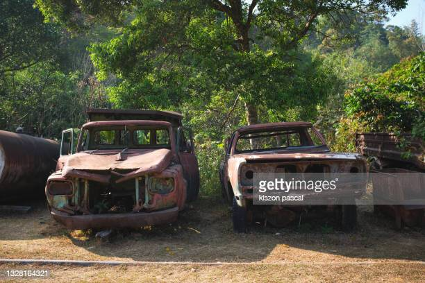 old rusty car and truck on an abandoned parking . - damaged stock pictures, royalty-free photos & images