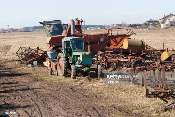 Old rusty farm machinery on the field in countryside