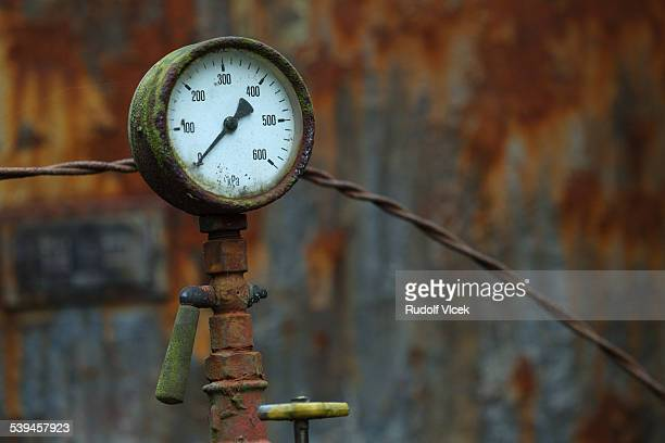 Old rusty gauge, dial, scale