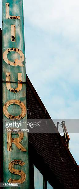 old rusty liquor sign - lyn holly coorg stock photos and pictures