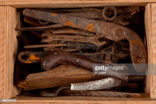 Old rusty tools in wooden box