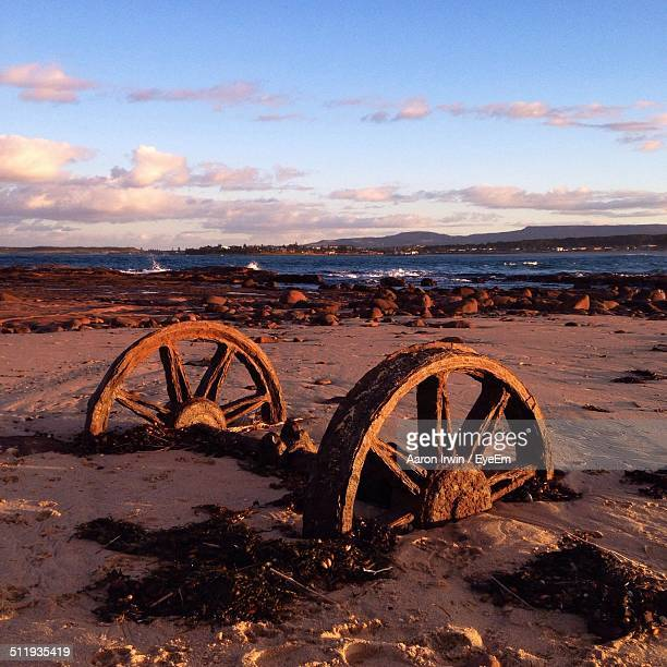 Old rusty train wheels on beach