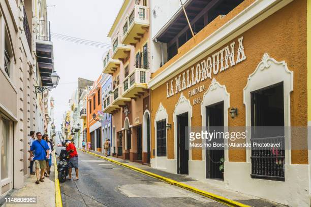 old san juan, calle san justo - old san juan stock pictures, royalty-free photos & images