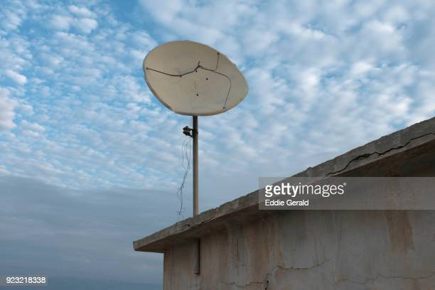 Old satellite dish over an abandoned structure near Kalia Beach, Dead Sea, Israel