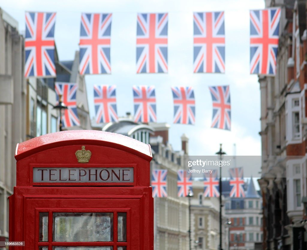 Old School Telephone Booth In Front Of Union Jack Stock Photo