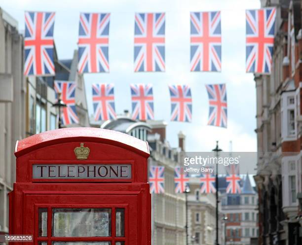Old school telephone booth in front of Union Jack