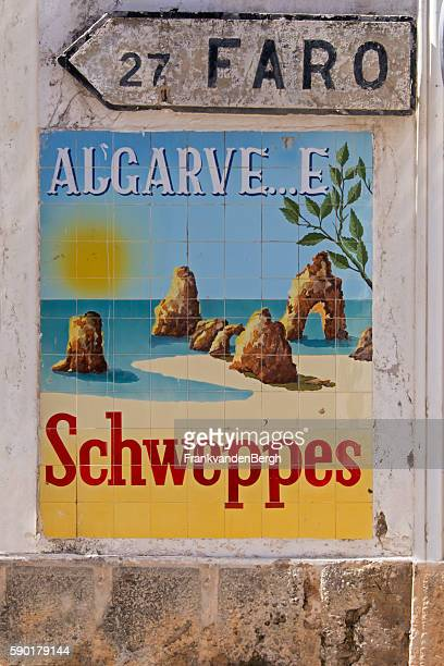 Old schweppes advertisement and directions sign to Faro