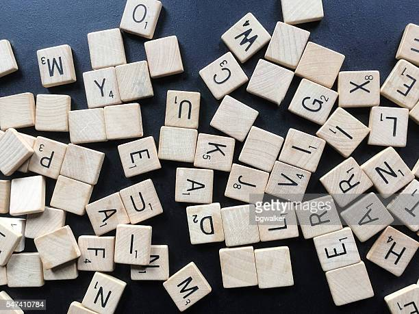Old Scrabble Tile Letters in Abstract Pile