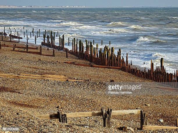 Old sea defences at Pett Level with rough sea