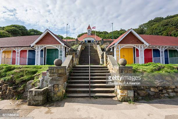old seaside beach huts at scarborough, north yorkshire - scarborough uk stock pictures, royalty-free photos & images