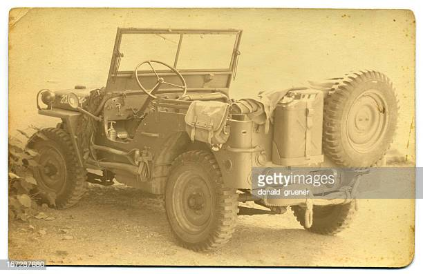Old sepia photograph of army jeep