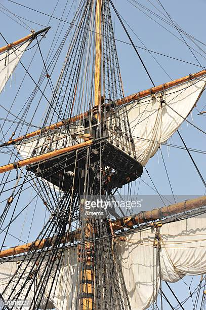 old ship setting sails - old frigate stock photos and pictures