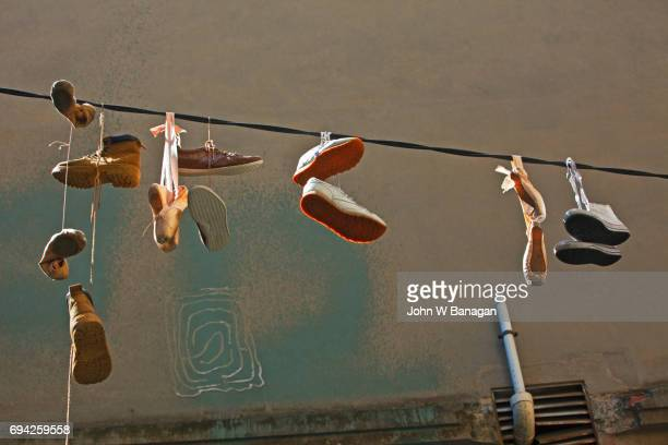 Old shoes hanging on street wire