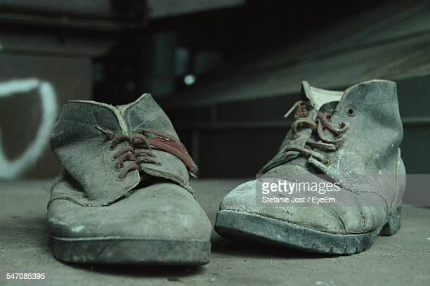 Old Shoes On Table