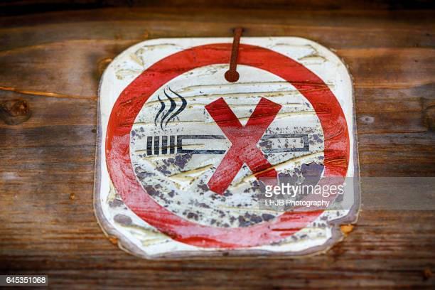 Old sign of no smoking