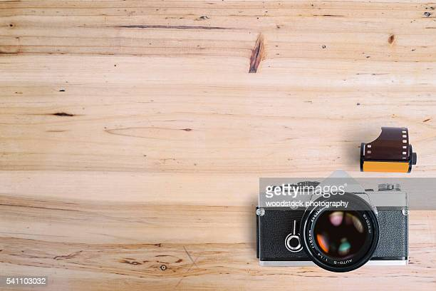 Old SLR vintage camera on wooden background