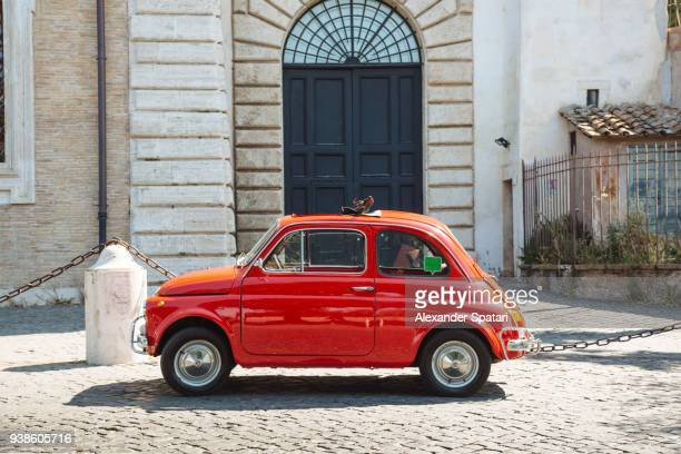 old small red vintage car on the streets of rome, italy - 横からの視点 ストックフォトと画像