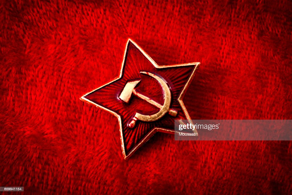 Old Soviet badge with the red star, sickle and hammer : Stock Photo