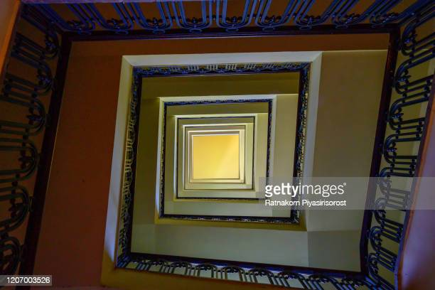 old square spiral stairway case from below - treasuregold stock pictures, royalty-free photos & images