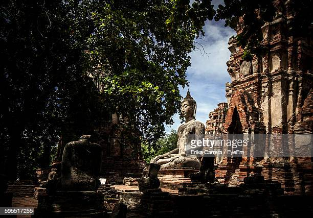 old statue and buildings at ayutthaya - asia carrera stock photos and pictures